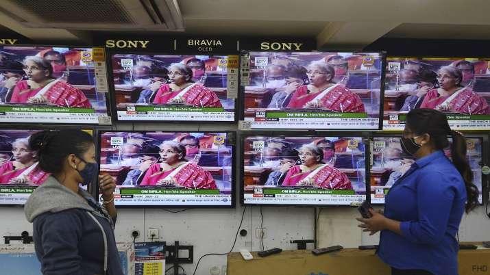 People watch Finance Minister Nirmala Sitharaman presenting
