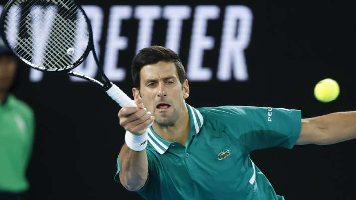 Serbia's Novak Djokovic makes a forehand return to France's
