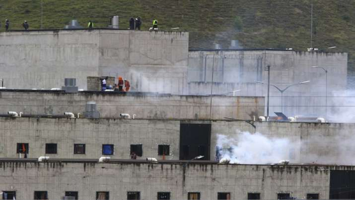 Tear gas rises from parts of Turi jail where an inmate riot broke out in Cuenca, Ecuador