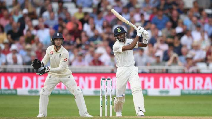 India Tv - India batsman Hardik Pandya hits out watched by Jos Buttler during day four of the 3rd Test Match between England and India at Trent Bridge on August 20, 2018