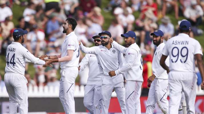 India Tv - Ishant Sharma of India celebrates with Hanuma Vihari after taking the wicket of Ross Taylor of New Zealand during day two of the First Test match between New Zealand and India at Basin Reserve on February 22, 2020