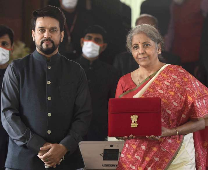 India Tv - New Delhi: Finance Minister Nirmala Sitharaman holds a folder case containing the Union Budget 2021-22, during the Budget Session of the Parliament, at Parliament House in New Delhi, Monday, Feb. 1, 2021. MoS Finance Anurag Thakur is also seen.