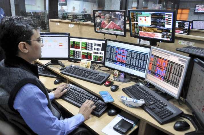 India Tv - Kolkata: A share broker watches stock prices on a screen as Union Finance Minister Nirmala Sitharaman presents Union Budget 2021-22, in Kolkata, Monday, Feb. 01, 2021