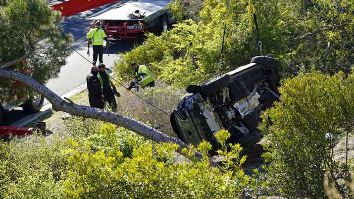India Tv - A vehicle rests on its side after a rollover accident involving golfer Tiger Woods Tuesday, Feb. 23, 2021, in the Rancho Palos Verdes suburb of Los Angeles. Woods suffered leg injuries in the one-car accident and was undergoing surgery, authorities and his manager said.