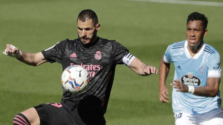 Real Madrid's Karim Benzema, left, controls the ball in