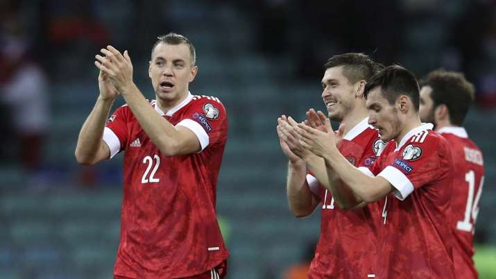 Russia's Artyom Dzyuba, left, reacts after the World Cup