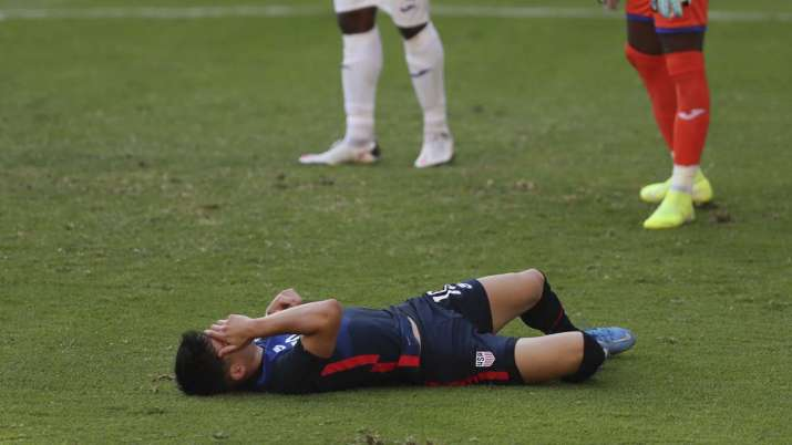 United States' Sebastian Soto grimaces in pain during a