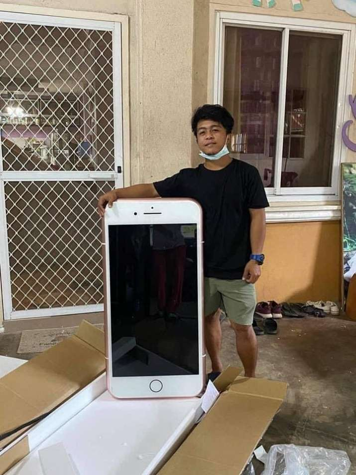 India Tv - Teen boy orders cheap iPhone, receives iPhone shaped coffee table instead; see pictures