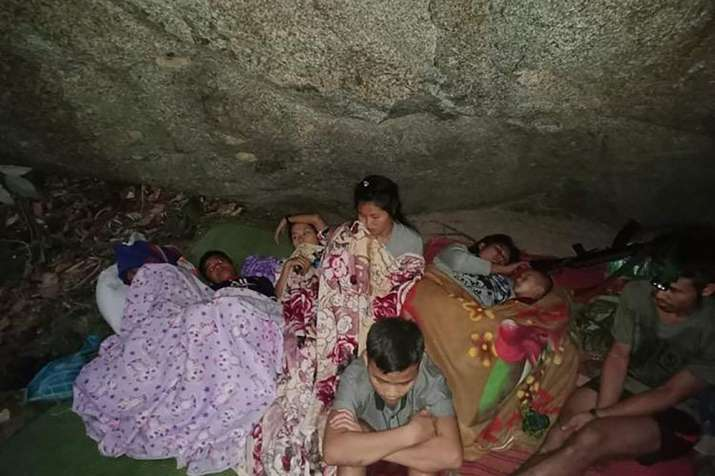 Villagers shelter in the open due to airstrikes in Deh Bu Noh, in Karen state, Myanmar.