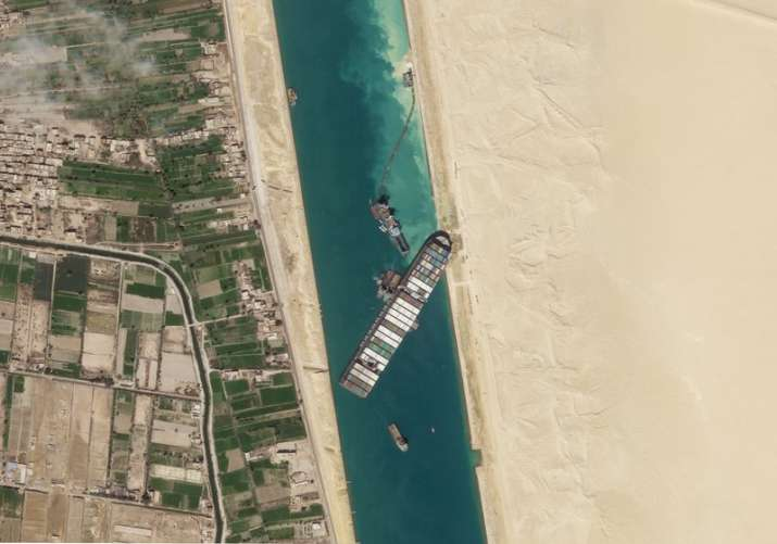 Satellite file image from Planet Labs Inc, the cargo ship MV Ever Given sits stuck in the Suez Canal