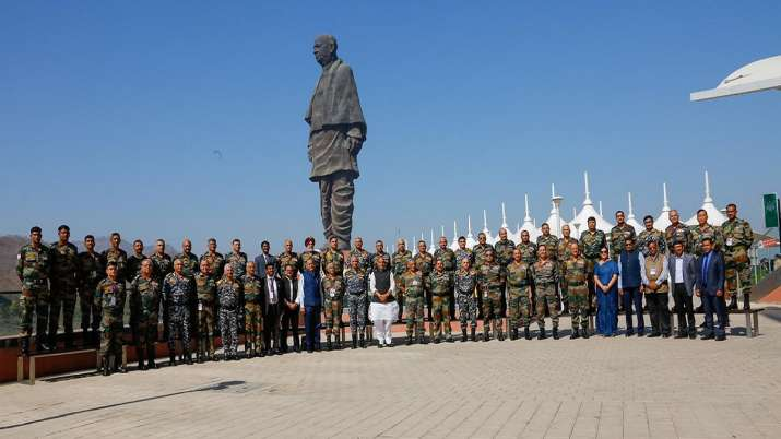 India Tv - Union Defence Minister Rajnath Singh, in a group photo with Tri-service Commanders, at the Combined Commanders' Conference at Kevadia, Narmada district of Gujarat on Friday, March 05, 2021. Also seen are Chief of Defence Staff General Bipin Rawat, Chief of Army Staff General M M Naravane, Chief of Naval Staff Admiral Karambir Singh, Chief of Air Staff Air Chief Marshal R K S Bhadauria, Defence Secretary Dr Ajay Kumar, Secretary (Defence Production) Shri Raj Kumar and Secretary, Department of Defence R&D and Chairman Defence Research and Development Organisation (DRDO) Dr G Satheesh Reddy.