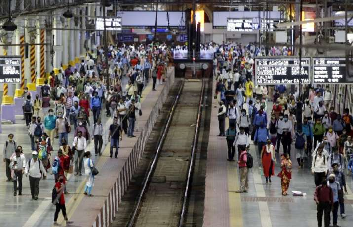 Commuters wait to board suburban trains at Chhatrapati