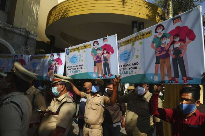 Police officers hold banners during an awareness drive for