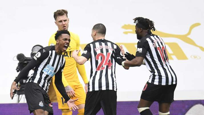 Newcastle's Joe Willock, left, celebrates with teammates