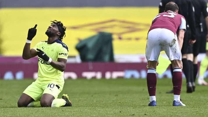 Newcastle's Allan Saint-Maximin, left, reacts following the