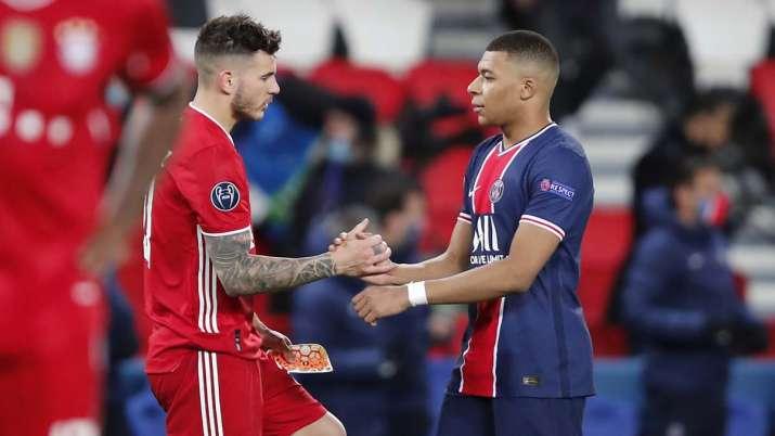 PSG's Kylian Mbappe, right, greets Bayern's Lucas Hernandez