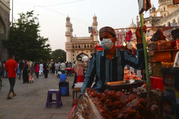 A vendor wearing a face mask as a precaution against