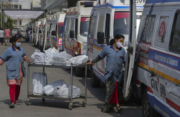 Hospital staff distribute food packets to the staff of
