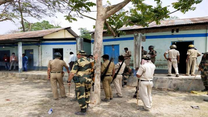 Security personnel keep vigil at a polling station after