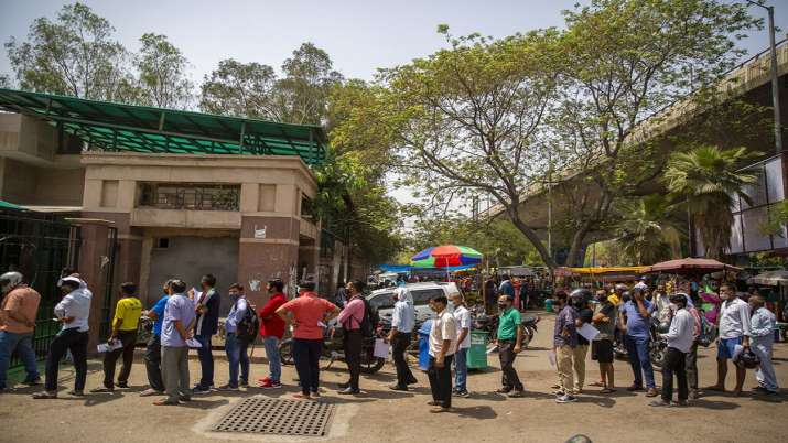 People wait for their turn to be tested for COVID-19 at a
