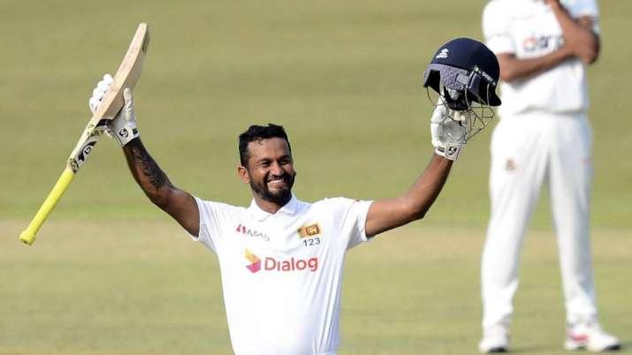 Sri Lanka batsman Dimuth Karunaratne celebrates scoring his