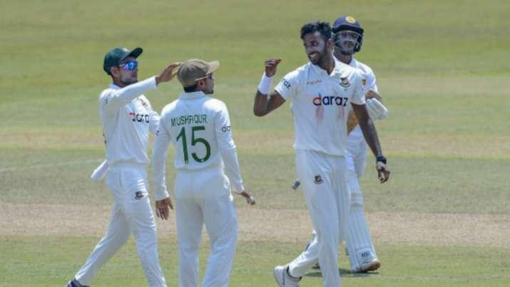 Bangladeshi bowler Ebadat Hossain, right, celebrates after