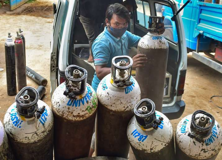 Workers sort medical oxygen cylinders meant for Covid-19