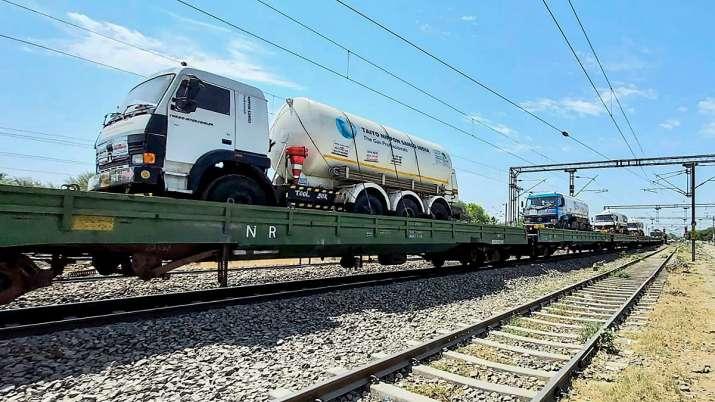 Oxygen tankers loaded on a train wagon.