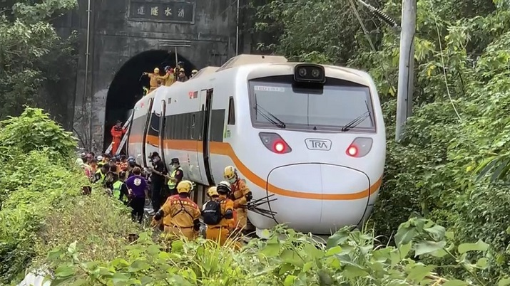 Rescue workers gather near one end of the train involved in