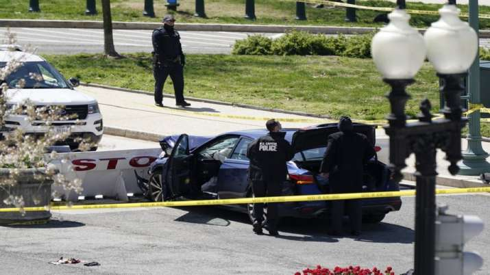 US Capitol Police officers stand near a car that crashed