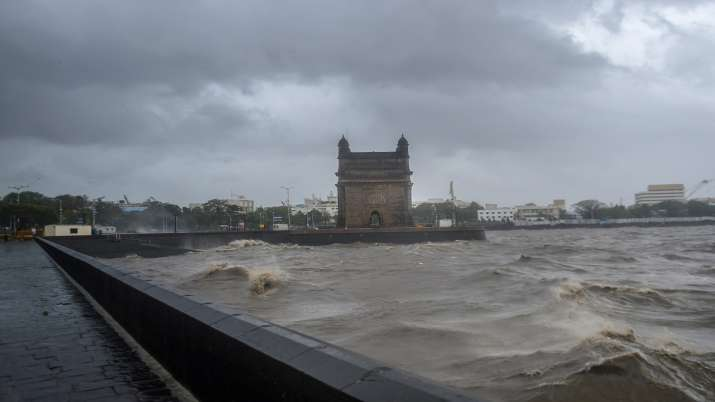 Indian Navy deploys 3 warships to rescue over 400 people onboard 2 barges adrift off Mumbai