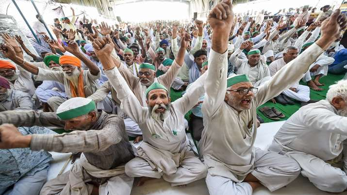 Farmers raise slogans during a panchayat on the National