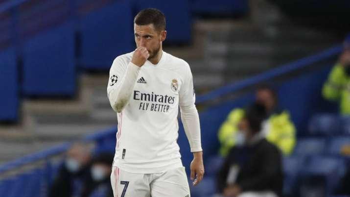 Real Madrid's Eden Hazard gestures after Chelsea's Mason