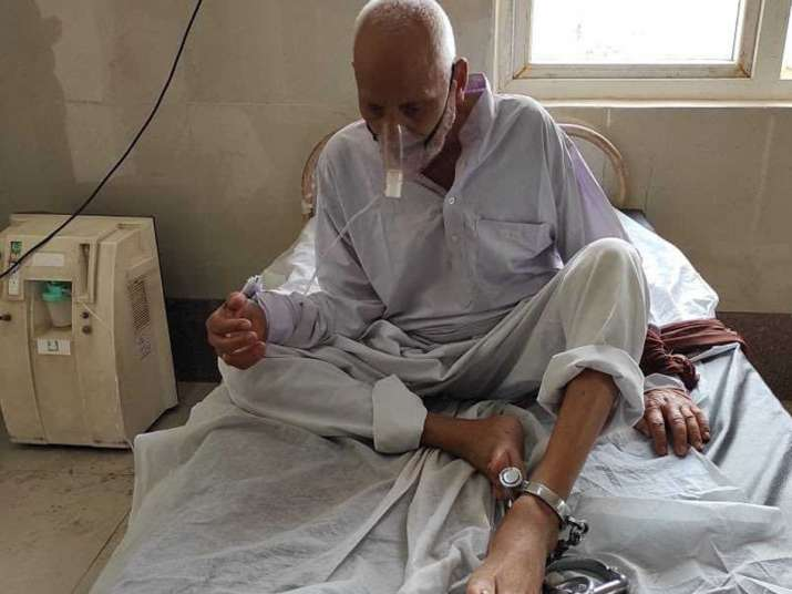 In picture,90-year-old prisoner chained during treatment