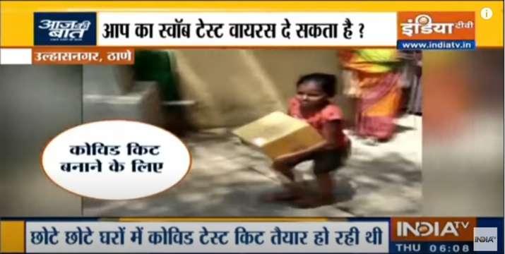 Women and children in the slum of Ulhasnagar found packing