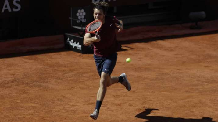 Taylor Fritz of the United States returns the ball to