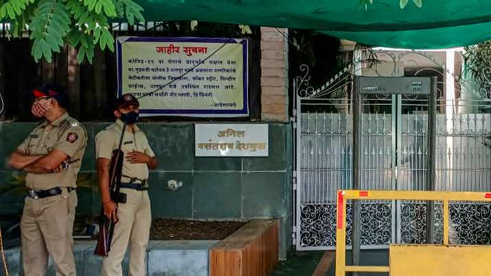 Police personnels stand guard at the residence of Anil