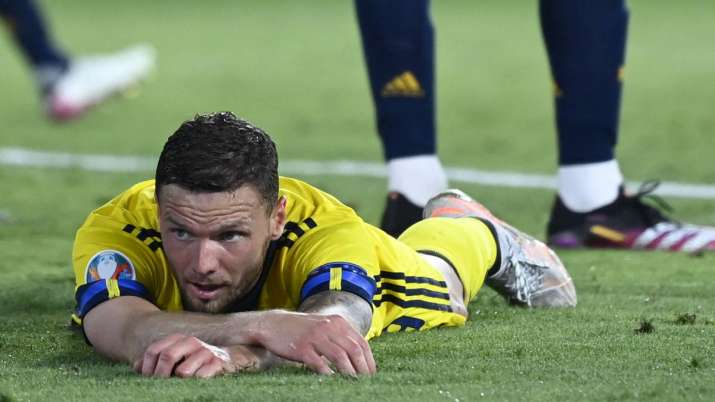 Sweden's Marcus Berg lies on the pitch during the Euro 2020