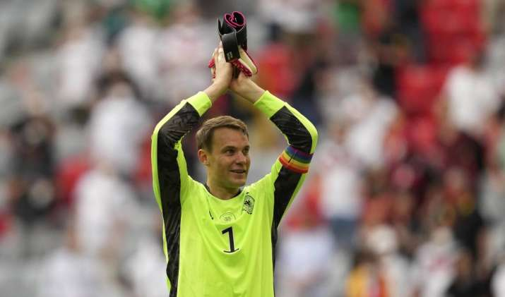 Germany's goalkeeper Manuel Neuer celebrates with fans