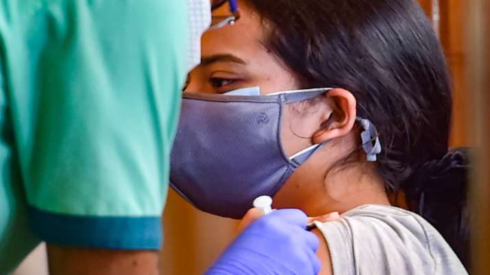 A health worker administers a dose of the Covid-19 vaccine