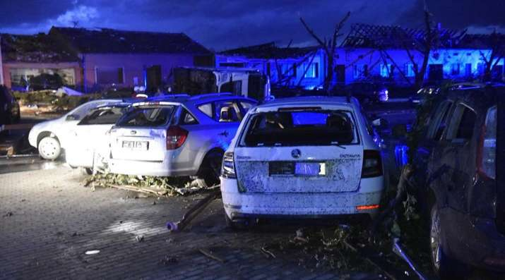 Cars and houses are damaged after a tornado hit the village