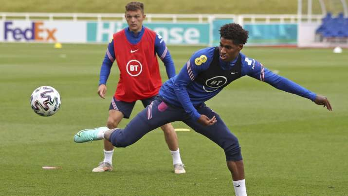England's Marcus Rashford stretches for a ball during the