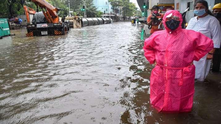 Mumbai Mayor Kishori Pednekar stands on a waterlogged road