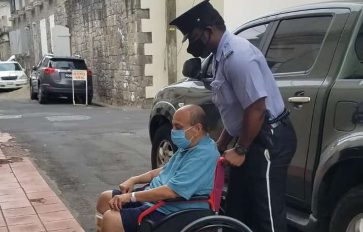 Mehul Choksi is taken in a wheelchair to the Magistrates