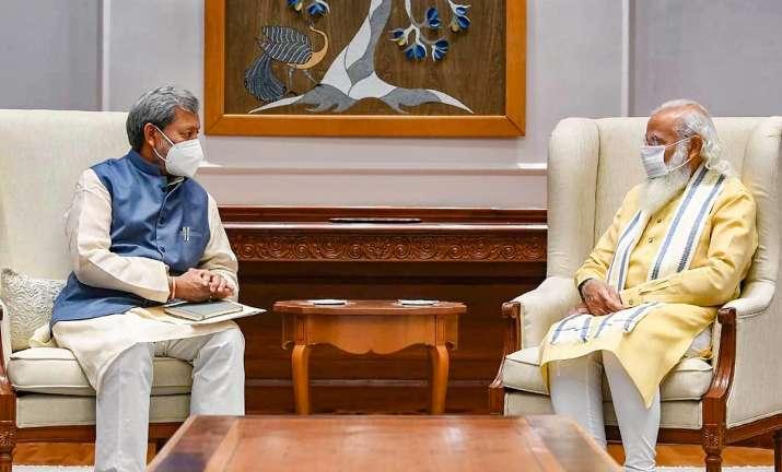 Tirath singh rawat meets PM