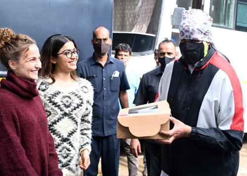 India Tv - Rashmika Mandanna, Elli Avrram surprise Amitabh Bachchan with cake and flowers on Father's Day | PHO