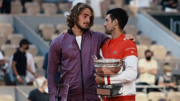 Serbia's Novak Djokovic, right, and Stefanos Tsitsipas of
