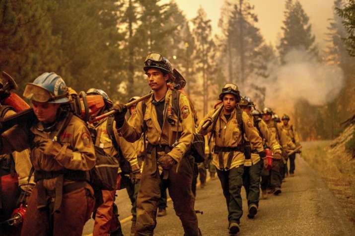 India Tv - Cal Fire firefighters battle the Dixie Fire near Prattville in Plumas County, Calif., on Friday, July 23, 2021.