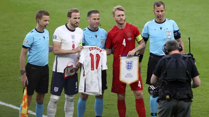England's Harry Kane, 2nd left, hands to Denmark's Simon