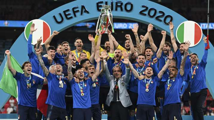 Italy's team celebrates with the trophy on the podium after